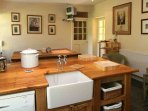 The rustic country style kitchen/dining area