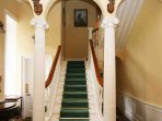 A fine feature staircase with triple arch leads to the accommodation levels