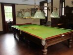 A snooker table is located in the basement