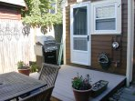 Outdoor private patio/deck with small garden.