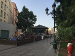 Junto a la plaza de La Nogalera y estación de tren.