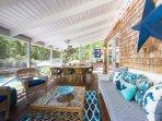 Screened Living & Dining Area Overlooks Pool