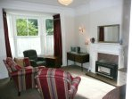 The lounge has views across to leafy Blenheim Gardens.