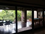 Sliding doors that completely open on to the veranda, BBQ and swimming area