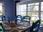 Dining Room overlooks the beach & Ocean.  Wonderful breezes!