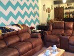 Our comfy couches in our uniquely painted living room