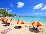 Relax on beautiful Waikiki Beach directly across the street