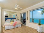 bedroom with king bed and beach views