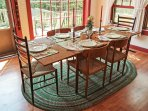 Indulge in a delicious home-style plate at the spacious dining room table.