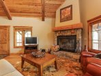 Staircase Chalet 15 - Living room with fireplace and TV
