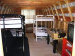 Optional bunkhouse has Foosball and other games for the kids