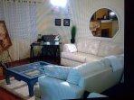Comfy white sofas and rug