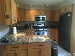 State of the art kitchen with granite countertops