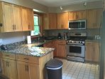 Gas stove, microwave, dishwasher and fully stocked