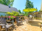Beautiful side deck offers seating, privacy and BBQ space