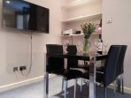 sitting and dinning area, large smart tv and unlimited high speed WIFI