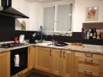 kitchen with granite bench top and high grade appliances including dishwasher
