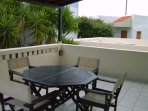 Spacious balcony with sun lounders and dining furniture