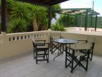 Very large spacious balcony with sun loungers and dining furniture