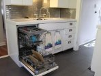 Here it is!  Our Bosch dishwasher.  Custom install in 1940s era metal cabinets.