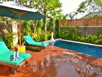 soak in the tropical sun of sanur by the pool