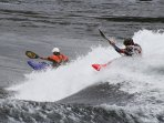 Extreme kayakers at Skookumchuck Reverse Tidal Waters putting on a show
