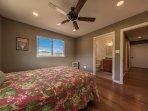 Downstairs bedroom with queen bed and en suite bath