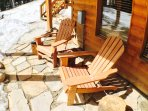 Adirondack chairs and gas fire pit to relax on the flagstone patio.