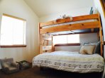 2nd bedroom with a twin over double bunkbed.