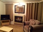 Beautiful lounge, with safe fireplace, blowing hot & warm heat. Tv, with Dvd player & Dvd'd suplied.
