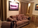 A comfortable lounge, with sofa bed to sleep up to 2 guests. making this lounge a suitable 4th room.