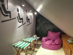 Kid's play cubby & reading nook in loft