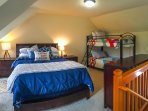 Sleeping loft with queen bed, twin bunks and working desks