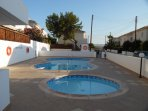 Shared unheated pool / chillds splash pool with showers and changing rooms.