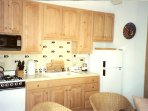 Full kitchen with microwave oven, refer, full range, all counter-top appliances.