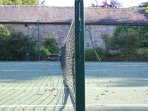 Private tennis court for use by guests