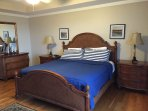 The King Master bedroom with hardwood floors and ensuite bath