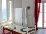 From the kitchen you have a great view of the sea, the town of Hermoupolis and the islands around.