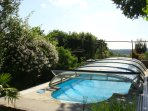 Solar heated and roofed pool
