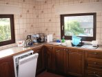 Well-equipped kitchen includes dishwasher and microwave as well as oven and hob