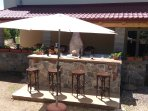 BAR NEAR barbecue in the garden behind the house