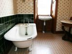 Antique roll top bath and vintage fittings