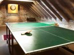 Above the snooker room is additional games space accessed by a ladder