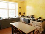 The kitchen is bright and well equipped for self catering groups