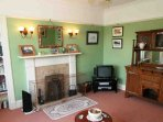 The cosy, more traditionally styled sitting room houses the TV
