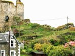 The ruins of The Royal Castle of Tarbert perched above the town