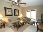 Living Room with Double Doors to 10' x 30' Private Sun Deck with Table & Loungers