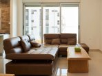 Italian leather couch fully expandable for maximum reclining, with a large 4G TV.