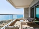 Porch view from master bedroom overlooking the sea, 5 plush seats coffee table and barbecue