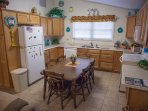 Full kitchen with all necessary appliances including oven, microwave, coffee pot